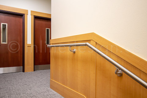 top of stairs handrail commercial return to wall