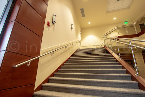 wide angle view stairways glass railing