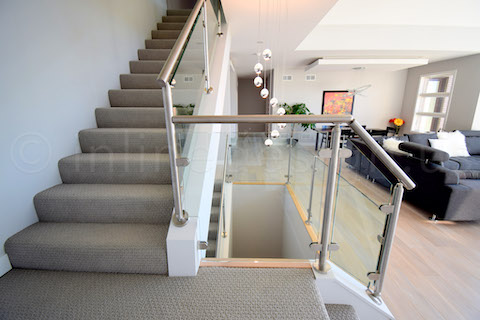 Stairs with glass railing and steel posts