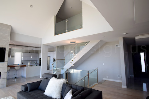 Interior glass railing with steel posts