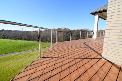 Deck made of wood with steel cable railing
