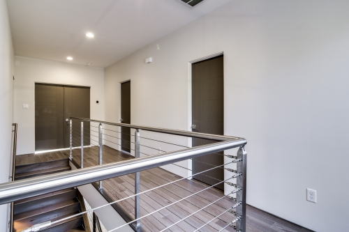 stainless steel cable railing wood floor