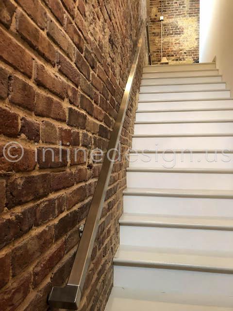stairs handrail brick wall